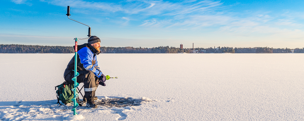 Ice fishing in finland is an exotic way to enjoy nature for Fishing in finland