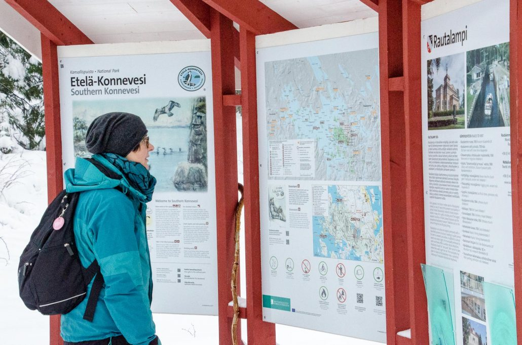 Inspecting trail information at Vuori-Kalaja